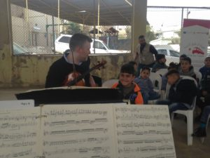 Mike and Syrian refugee children at an elementary school in Zarqa 2018