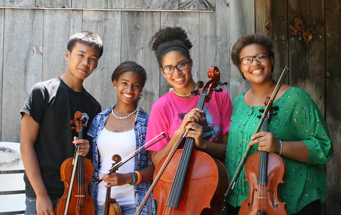 A student quartet from Community MusicWorks at Apple Hill